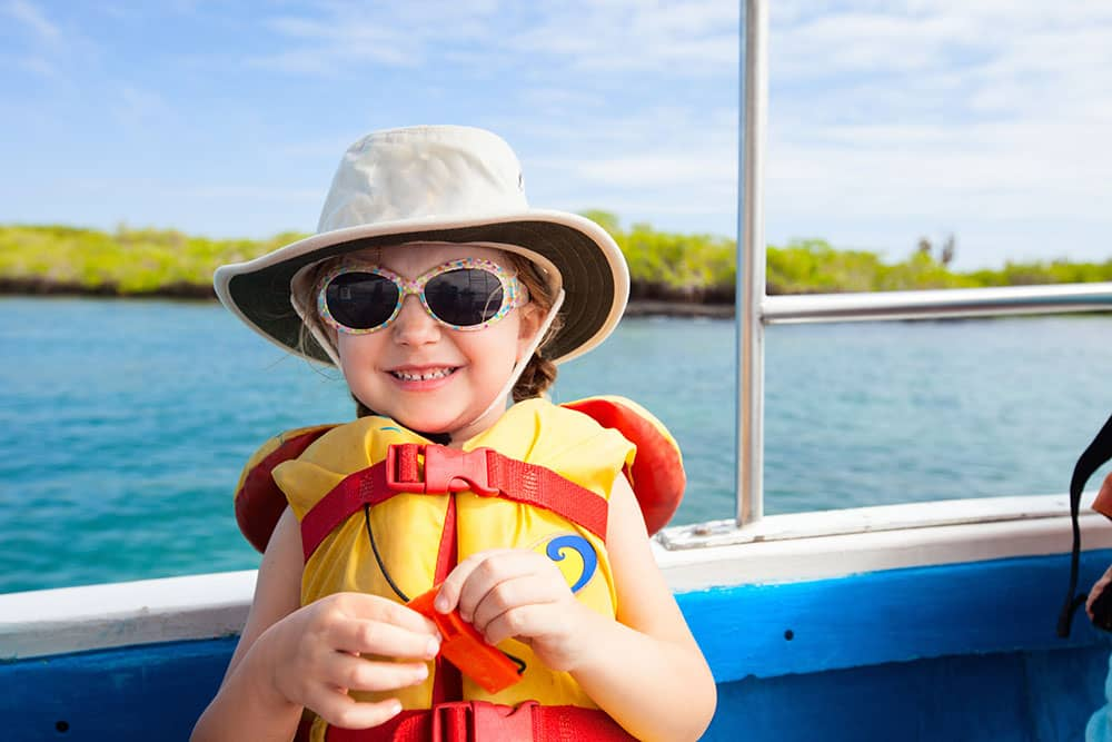 Young Girl in Sunglasses on Boat