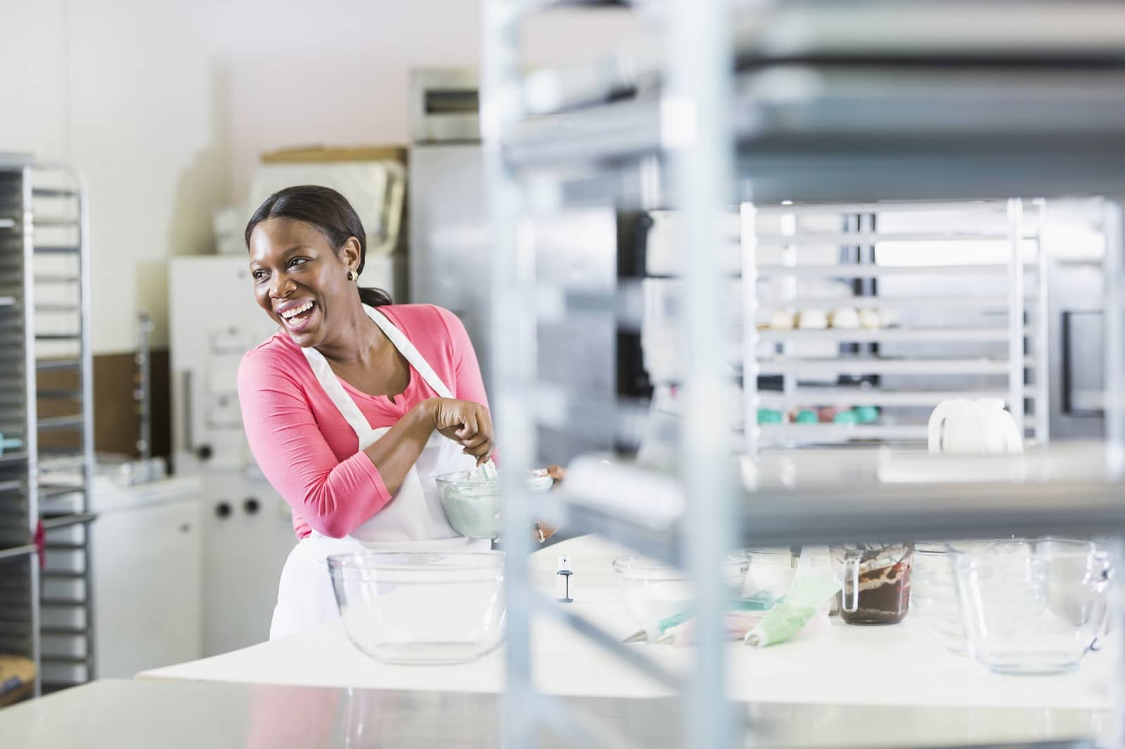 Woman working in bakery kitchen