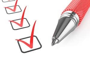 red pen on checklist