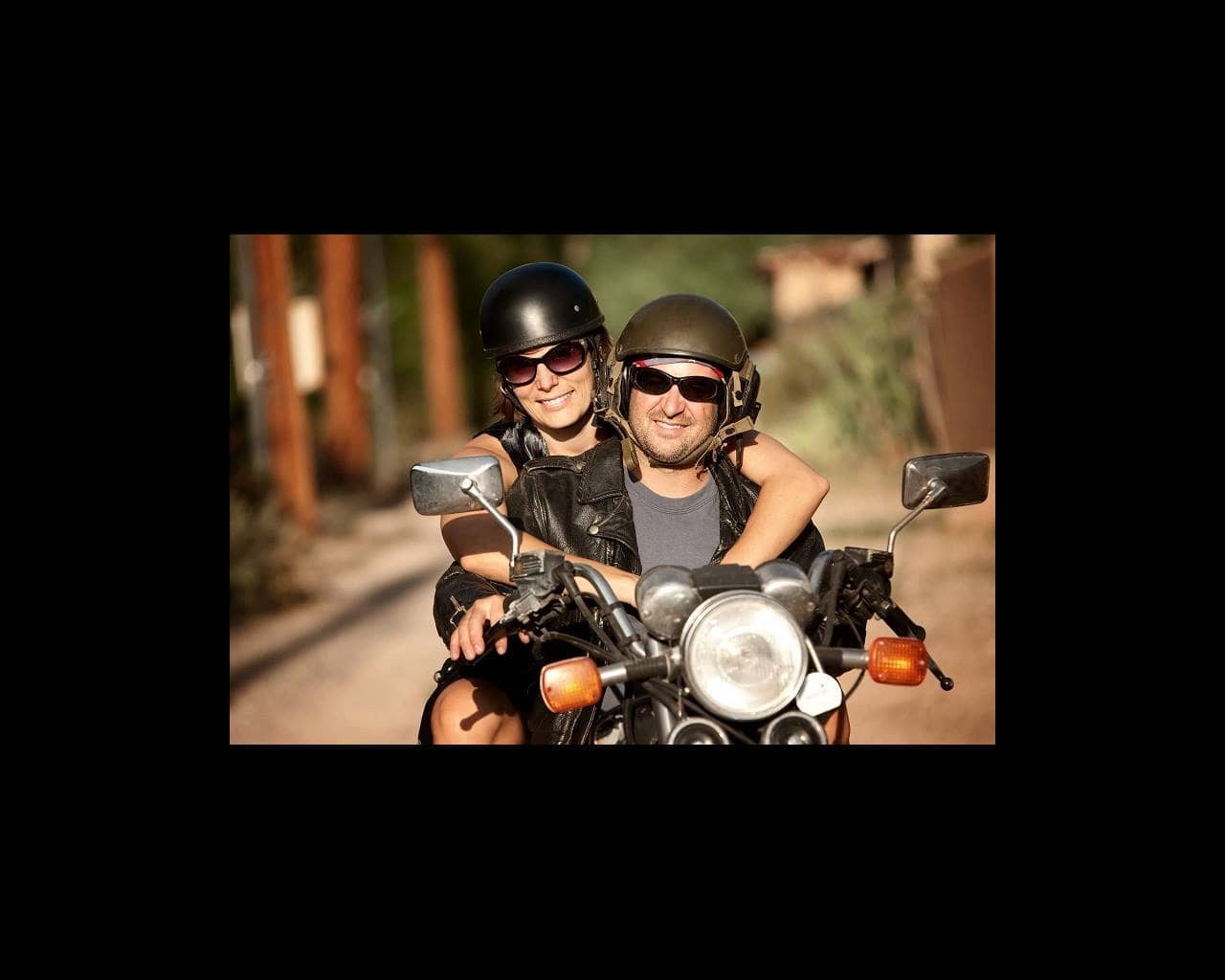 Man and woman on motorcycle