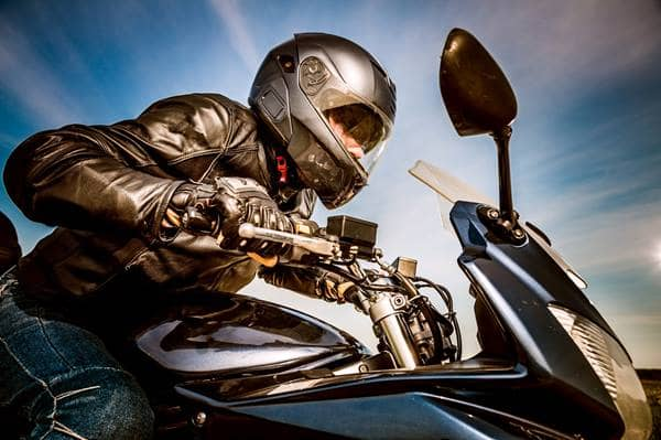 man wearing protective gear on motorcycle