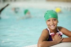 girl in pool with swim cap
