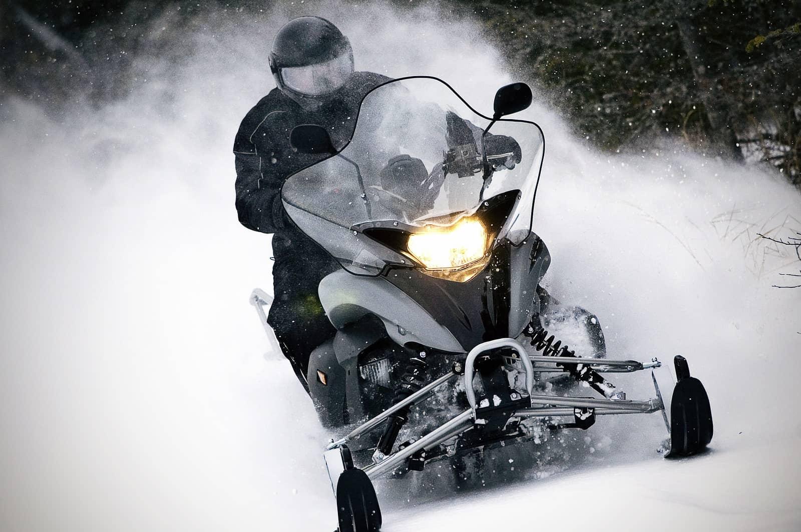 snowmobile kicking up snow