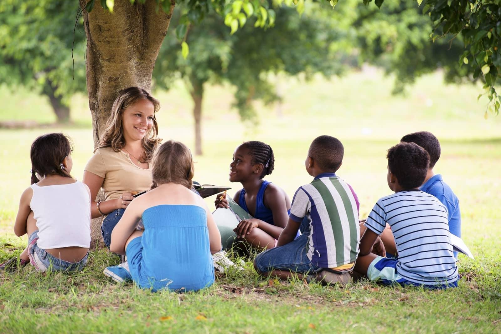 outdoor kids teacher under tree