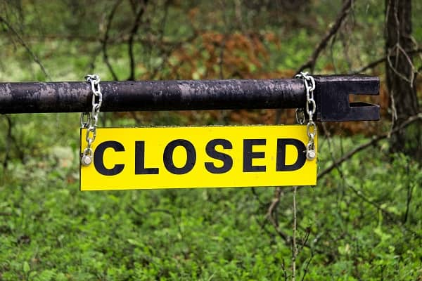 Closed sign and gate