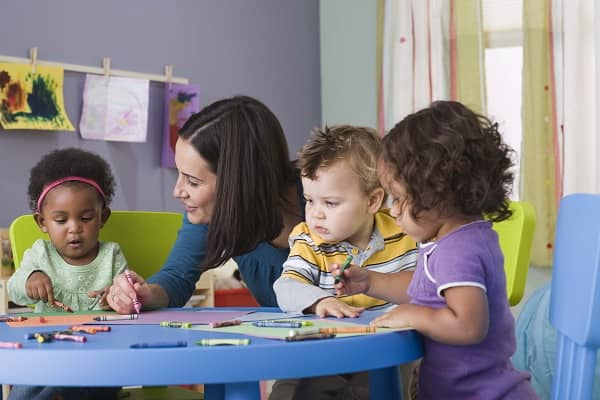 Teacher and toddlers in daycare