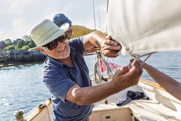 Older man rigging a sailboat