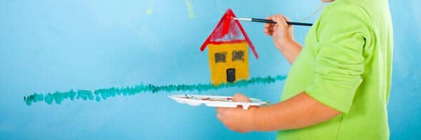 Child painting a sun and house