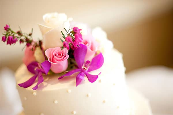 Wedding cake with pink and purple flowers